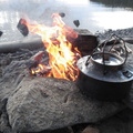 Kettle, flames, and a lake