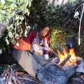 Life around the fire in a survival shelter